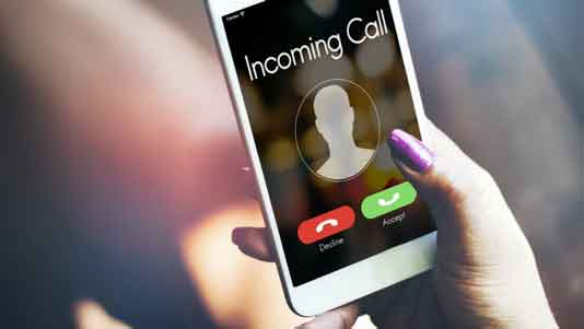 photo of smartphone with an incoming call notification displayed on screen